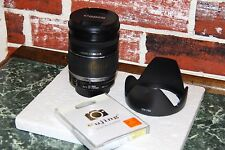 Canon EF-S 18-200 mm F/3.5-5.6 IS Lens with Hood and UV filter.