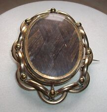A large Victorian oval double-sided mourning locket brooch / pendant