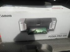 Canon Pixma Pro 100 Inkjet Printer with paper