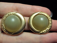 smooth + textured gold tone yellow round clip on earrings signed Butterfly