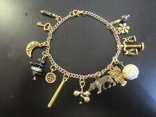 Hufflepuff House Harry Potter Charm Bracelet in Black and Gold Tone (8 charms)