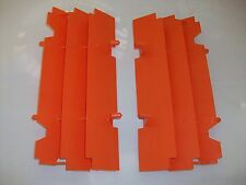 2 NEW OEM ORANGE KTM RADIATOR GUARDS SCREENS SHIELDS 125 200 250 300 SX EXC MXC