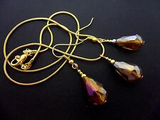 A  GOLD TONE AMBER GLASS CRYSTAL TEARDROP NECKLACE & EARRING SET. NEW.