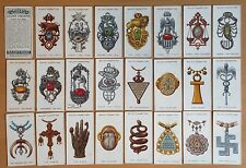 WILLS: LUCKY CHARMS 1923. Complete and original set of 50 cigarette cards.