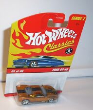 HOT WHEELS CLASSICS FORD GT-40 IN GOLD WITH STRIPES MINT ON CARD