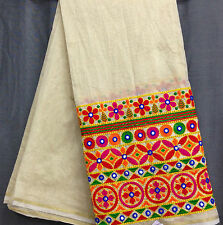 By HALF meter cream chanderi cotton mix fabric, kutch work. For blouse, buy 1mtr