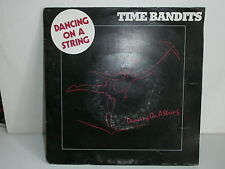 TIME BANDITS Dancing on a string A6726