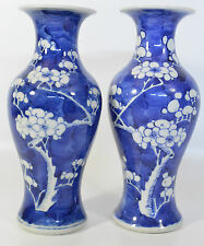 A pair of 19th century Chinese blue and white prunus porcelain vases Kangxi mark