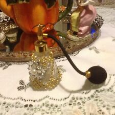 Rhinestone jeweled perfume bottle with jewels in clear and bulb spray