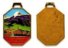 Medaglia Con Vernice Splugen Svizzera Metallo Dorato cm 2,7 x 3,6 g. 10,8