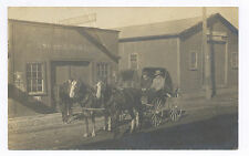 1911 RPPC PHOTO CARRIAGES AT HORSE SHOEING & REPAIR  BUSINESS