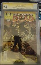 WALKING DEAD #1 CGC 9.8 DOUBLE SIGNED ROBERT KIRKMAN AND TONY MOORE IMAGE