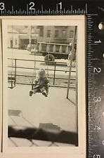 Vintage Photograph nice iconic image of little girl oblivious to city life 1940s