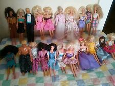A lot of. different Barbie's , Ken dolls, and other dolls.