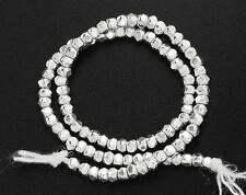 100 of Karen Hill Tribe Silver Faceted Seed Beads 2.3x1.5mm. 6.5 inches