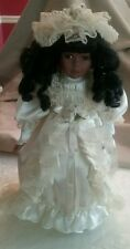 AFRICAN AMERICAN PORCELAIN GIRL DOLL IN A SATIN CHRISTENING DRESS AND HAT