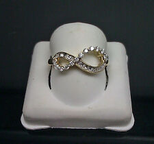10K Yellow Gold Ladies Infinity Ring With 0.24CT Round and Baguette Diamonds