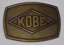 Kobe Industrial. Belt buckle. Bronze. Unused.