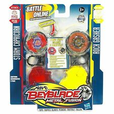 PACK 2 TOUPIES BEYBLADE STORM CAPRICORN / ROCK GASHER - HASBRO - NEUF EMBALLE
