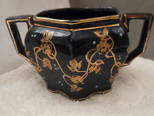 VINTAGE BLACK SIX SIDED SUGAR BOWL WITH GOLD COLOURED AND PALE BLUE ENAMEL TRIM