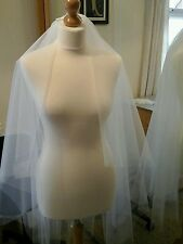 Bridal veil Ivory, 2 tier waist 36 and fingertip 45 ins length. Half gathered