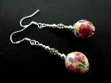 A PAIR OF DANGLY FLOWER PORCELAIN BEAD EARRINGS WITH 925 SOLID SILVER HOOKS. NEW