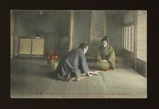 Japan Man giving Betrothal present to woman c1920/30s? PPC