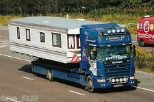 Truck Photo: A RHODES JNR CARAVAN HAULIER - SCANIA - X648 XKH - YORK Transport
