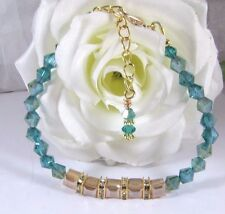 Bracelet Adorned With Green and Topaz Cube Swarovski Crystal Beads