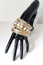 Gorgeous 10 piece shiny gold tone & silver glitter effect white bead bangle set