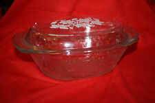 CLEAR GLASS OVAL FLORAL STYLED CASSEROLE DISH WITH LID AND BUILT-IN HANDLES
