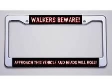 """NEW! WALKING DEAD FANS. """"WALKERS BEWARE!/...HEADS WILL ROLL!""""LICENSE PLATE FRAME"""