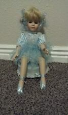 "9"" Music Box Porcelain Doll. Arms and legs move when music box is on"