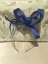 Sophisticated and simple cobalt blue loop fascinator with feathers and netting!