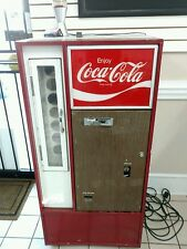 Vintage coke machine..Keeps drinks COLD!!..Functions as intended..!!