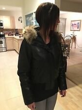 Andrew Marc genuine leather bomber jacket with duck down feathers and fur hood.