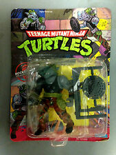 1988 PLAYMATES TEENAGE MUTANT NINJA TURTLES ROCKSTEADY UNPUNCHED CARDED FIGURE