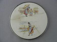 Dessous de plat faience de Sarreguemines jeunes filles parapluie Froment Richard