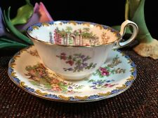 A SET OF AYNSLEY FOOTED CUP & SAUCER GARDEN GATE WHITE CHINA GOLD