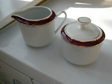 CHINA LIDDED SUGAR BOWL AND MILK JUG WITH DARK RED AND GOLD COLOURED BANDS