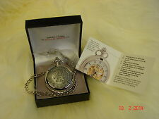 silver pocket watch mechanical