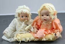 Lot of 2 Decorative Porcelain Baby Dolls w/ Pillow One Musical One not.