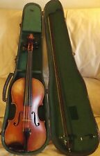 Old antique violin with a label. Plus an old bow all in an old case