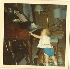 Old Vintage Photograph Little Baby Reaching For The Piano in Retro Livingroom