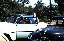 1950's Red Border Slide, Young Guy next to a couple of Old Cars / Plymouth