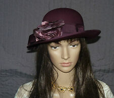 Wedding / Occasion hat by Kangol purple with bow and flowers to side