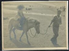 C1950's Photo Image Young Girl on a White Pony being lead by a Boy on a Beach