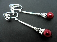 A PAIR OF DARK RED GLASS PEARL  SILVER PLATED   CLIP ON  EARRINGS. NEW.
