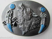 Wolf belt buckle howling wolf  and feathers.