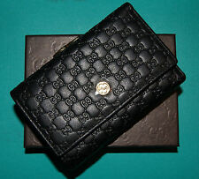 Gucci women's wallet. Black. Genuine leather. NIB.